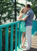 Sweet young couple kissing in the city summer — Stock Photo