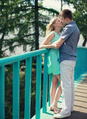 Sweet young couple kissing in the city summer — Photo