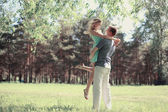 Tender photo lovely young happy couple in love, walking in sprin — Stok fotoğraf