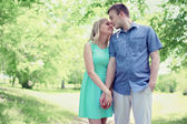 Lovely tender young couple in love walking in sunny spring park, — Stock Photo