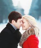 Beautiful happy sensual couple in love in cold sunny winter day. — Stock Photo