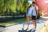 Couple teens in love walking in the park in summer day, youth, l — Stock Photo