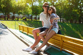 Stylish young couple teenagers in love, summer sunny day — Stock Photo