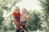 Autumn portrait happy family mother and son having fun outdoors — Stock Photo