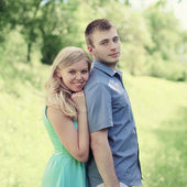 Portrait lovely young couple in spring day — Stock Photo