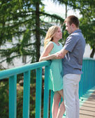 Pretty happy couple on the bridge in love — Foto Stock