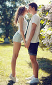 Pretty young couple in love, sensual kiss in sunny warm day — Stock Photo