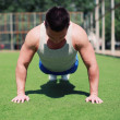 Sportsman push ups outdoors, fitness, workout, sport - concept — Stock Photo #53399907