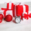 Christmas background, many gifts, decoration and alarm clock — Stock Photo