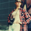 Street fashion, stylish pretty hipster girl in sunglasses with v — Stock Photo #56213191