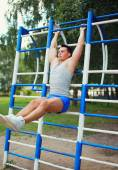 Sport, fitness and workout concept - sportsman doing exercise li — Стоковое фото