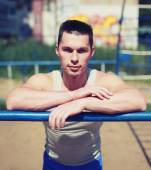 Street workout, portrait sporty man relaxing after training outd — Stock Photo