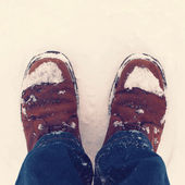 Winter hipster boots in the snow — Stock Photo