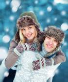 Happy young couple having fun playing outdoors in winter day — Stock Photo