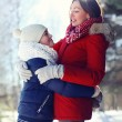 Life portrait of happy family, son hugs his mother in sunny wint — Stok fotoğraf #65968243