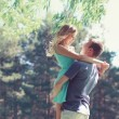 Sweet couple in love, woman and man enjoy each other in sunny sp — Stock Photo #67580447
