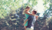 Sweet couple in love, woman and man enjoy each other in sunny sp — 图库照片