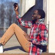 Fashion lifestyle photo happy young african man makes self-portr — Stock Photo #68631095