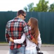 Portrait of beautiful young couple together in the city, wearing — Stock Photo #77472996