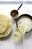 Top view of fresh poppadums served with raita and mango chuthey — Stock Photo