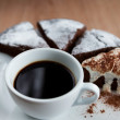 Cup of black cofee with chocolate cake — Stock Photo #62777373