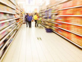 Interior of supermarket shelves — Stock Photo