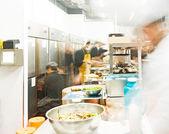 Chefs of restaurant kitchen — Stock Photo