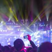 Audience silhouettes at concert — Stock Photo