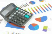 Financial charts and calculator — Stock Photo