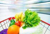 Shopping cart with fruits and Vegetables — Stock Photo