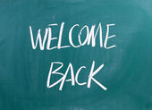 Welcome Back written on a blackboard — Stock Photo
