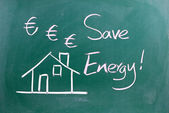 Energy Saving sign on blackboard — Stockfoto