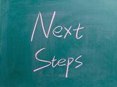 Next steps sign on blackboard — Stock Photo