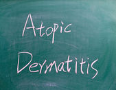 Atopic Dermatitis sign on blackboard — Stock Photo