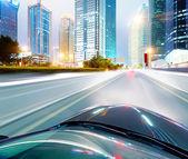 Car driving through city — Stock Photo