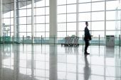 Man in hall of airport — Stock Photo