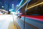 Speeding car go through the city — Stock Photo