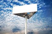 Blank white billboard against blue sky — Stock Photo