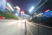 Car on road at night — Stock Photo
