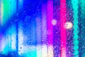 Wet window with night city — Stock Photo