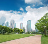 City park with modern buildings — Stock Photo