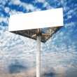 Blank white billboard against blue sky — Stock Photo #74374317