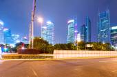 The light trails on the modern building background in shanghai — Stock Photo