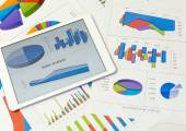 Financial charts with tablet — Stock Photo