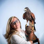 Woman and buzzard — Stock Photo