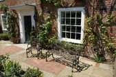 Wrought iron bench and chair — Stockfoto