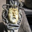 Постер, плакат: Sculpture of snakes biting a man head or brain torture pain Halloween decorattion