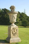 Sculptured urn on a plinth — Stock Photo