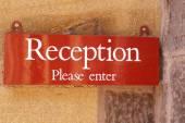 Reception please enter sign — Stock Photo