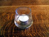 Candle in a glass on a table — 图库照片